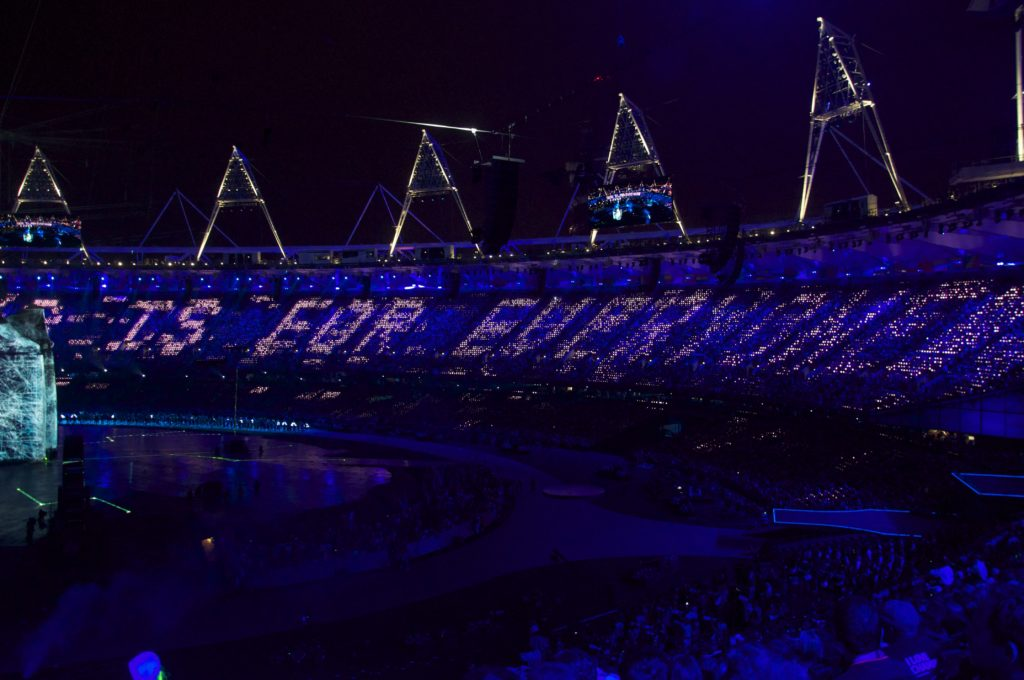 This is for Everyone, enormously projected on in a stadium onto the public