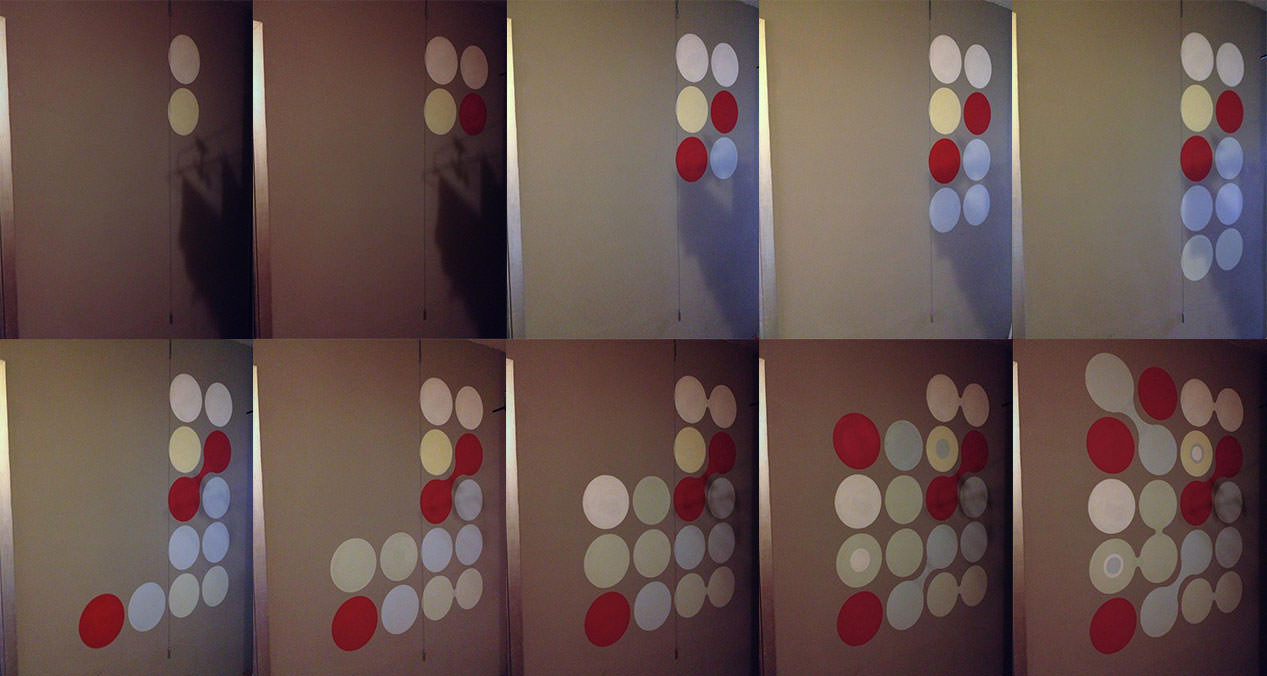 A sequence of the progress of painting balls onto the wall