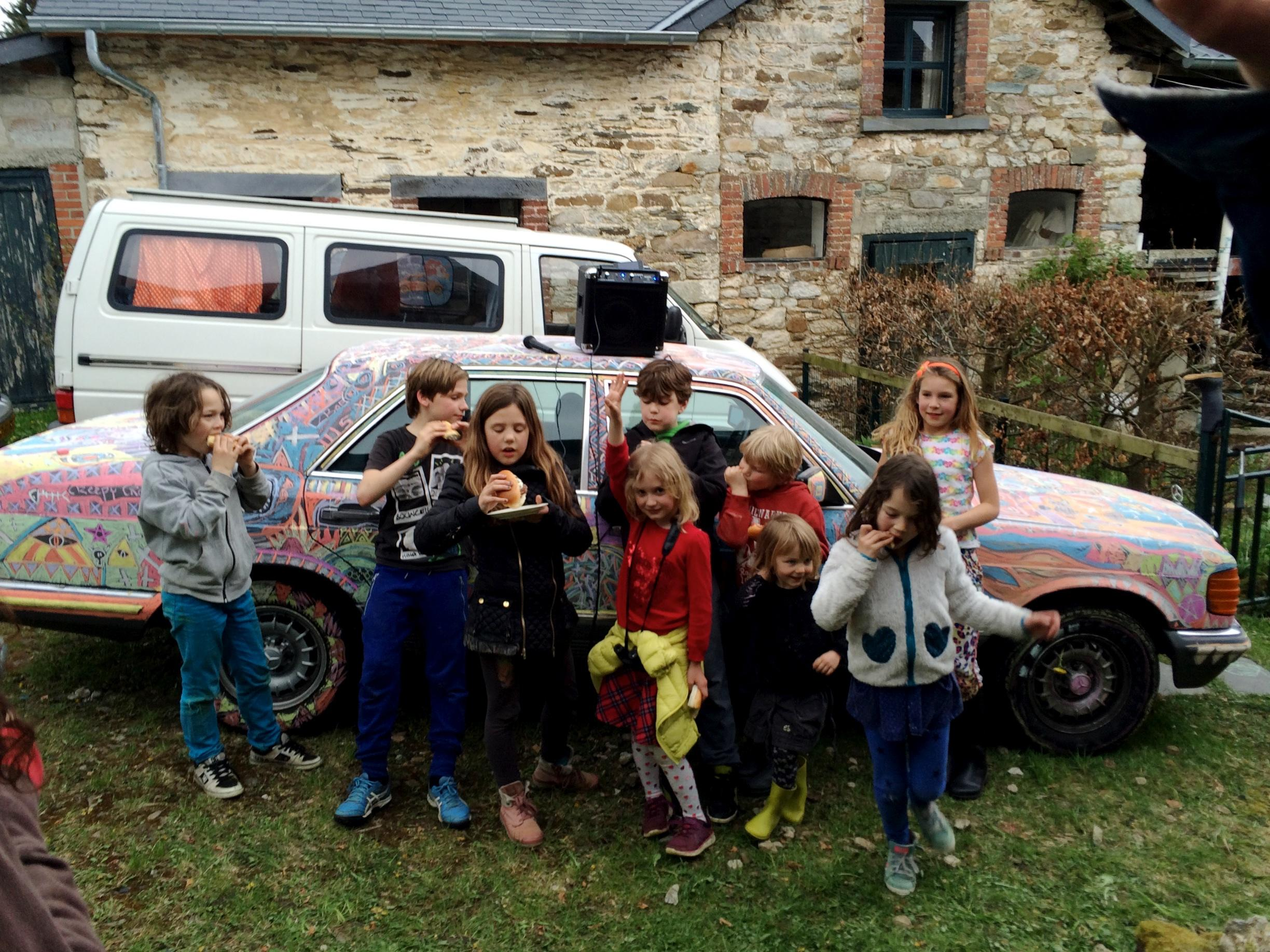 Happy kids who, of course, now understand that you can draw on cars, despite what grown ups may say