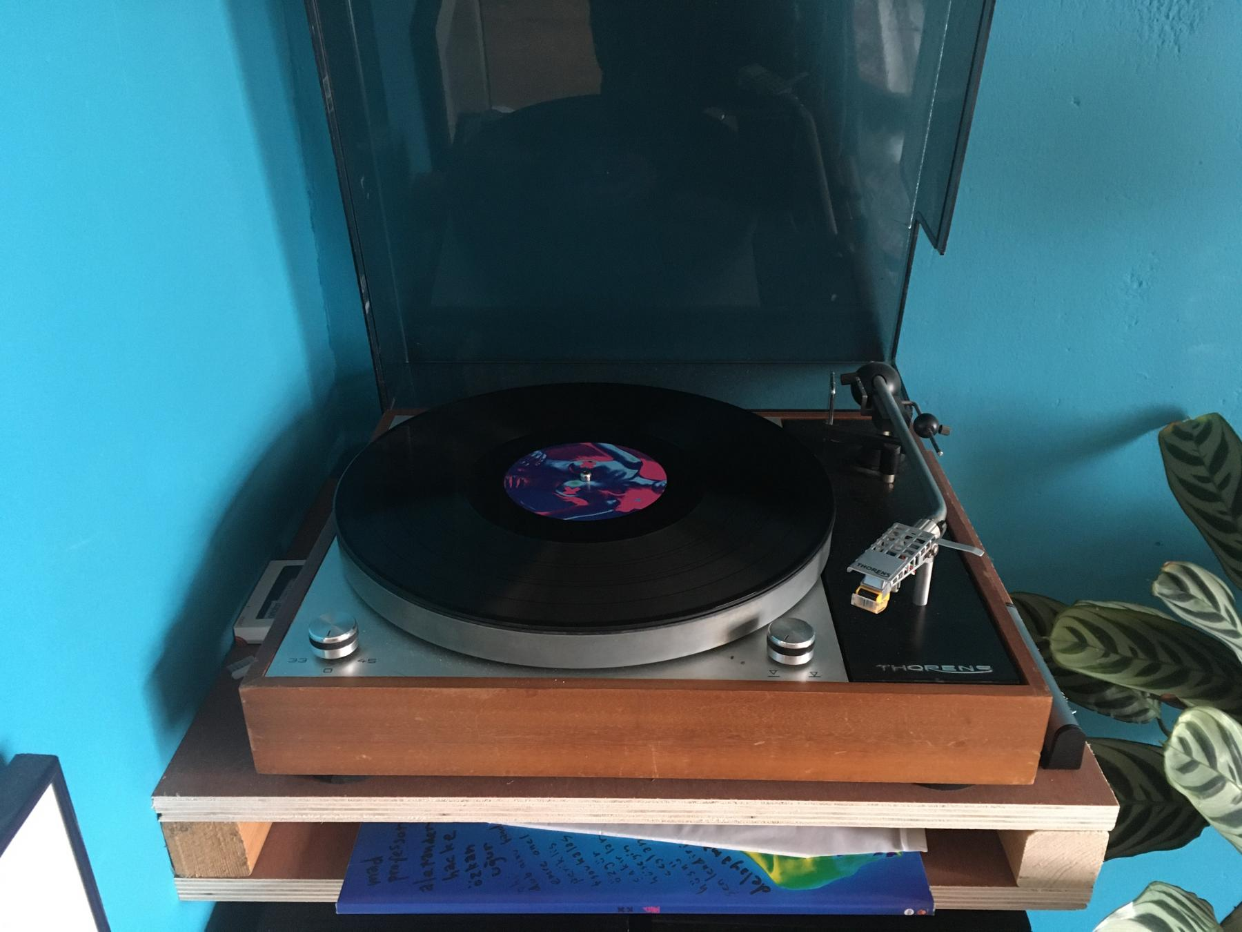A picture of our old record player with a record by Baba Zula on it